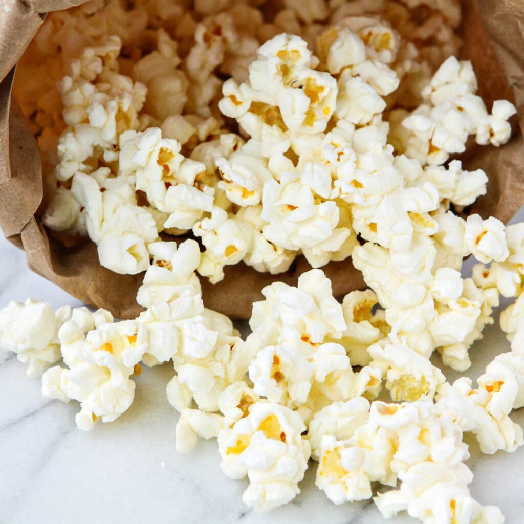 Top 10 Snacks Under 10 mins - Image of popcorn kept in a brown paper bag