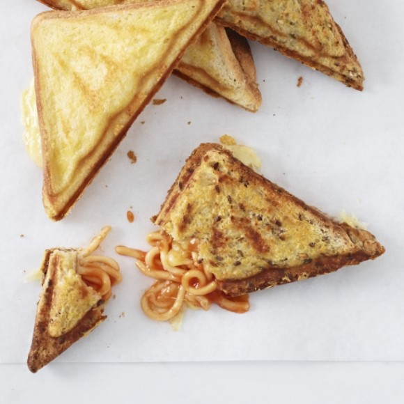 Top 10 Snacks Under 10 mins - Image of spaghetti cheese jaffles served in a porcelain plate