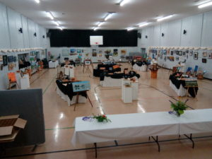 The Kearney Community Centre gym is set up with decorative tables for a craft show.