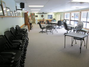 The Senior room, also the council chambers shows tables set up for a small meeting event.