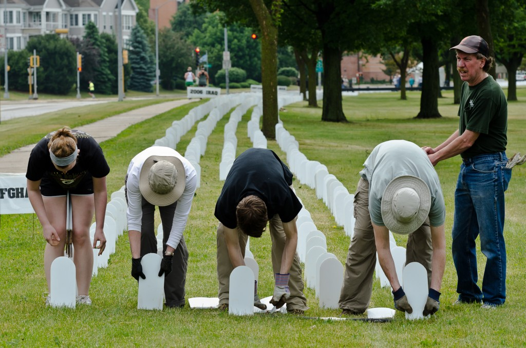 Volunteers are critical to installation of the 6,000+ tombstones (Photo by Paul McMahon)