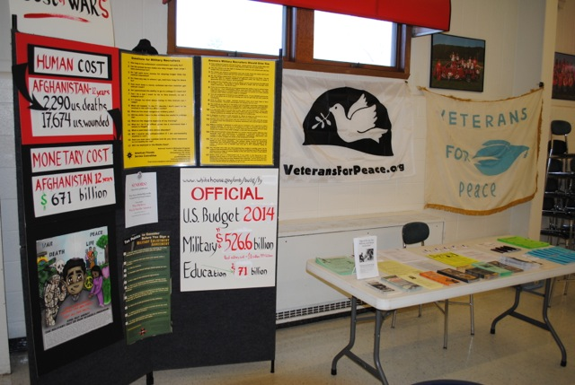 Chapter 25 counter recruiters have met with students at Boscobel High School for several years. This is the educational display set up in the cafeteria which encourages students to consider peaceful civilian alternatives to military recruitment. (Photo by David Giffey)