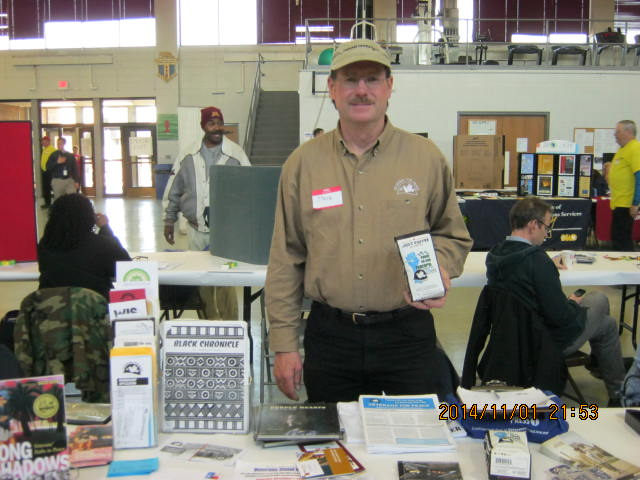 Steve Books represented Veterans for Peace, Chapter 25, at the Veterans Stand Down November 1, 2014, at the National Guard Armory, Madison. The day offered services and information to all veterans including homeless veterans. More than 100 veterans attended the stand down and received meals, haircuts, dental checkups, job information, and - thanks to Steve Books and Veterans for Peace - information about the costs of wars. Photo by Tom Glassel