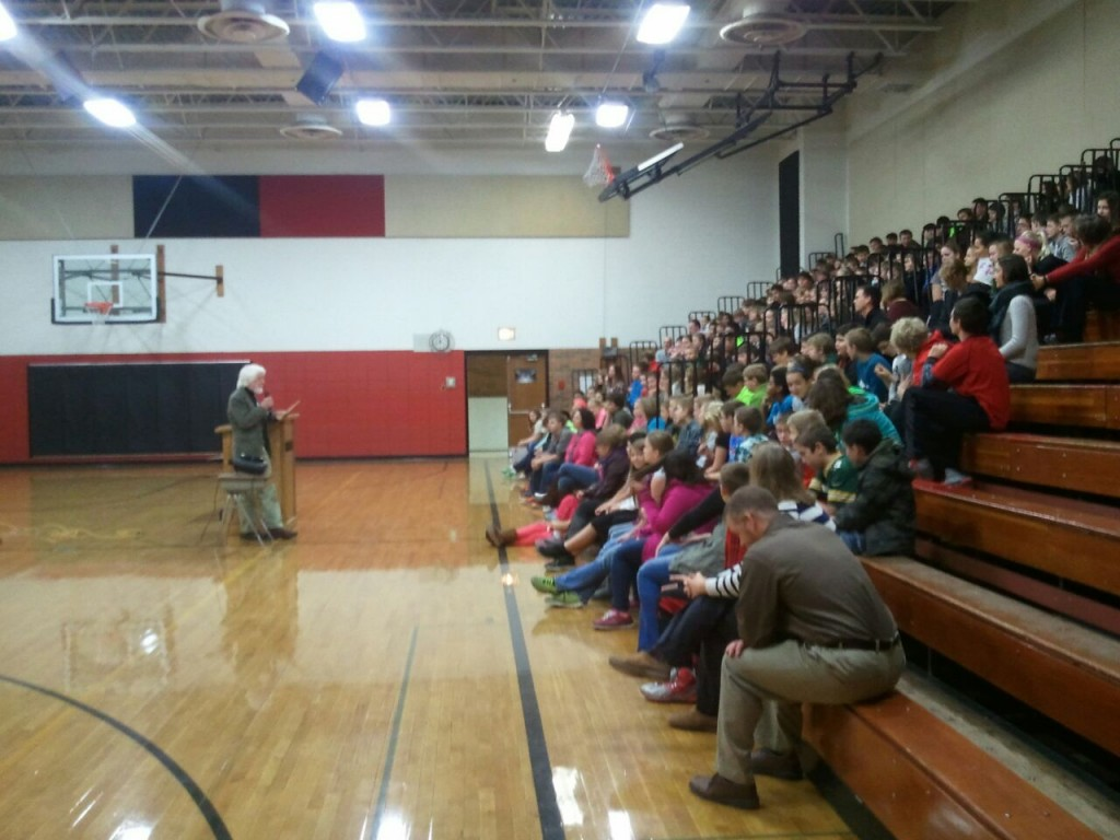 """Veterans for Peace member David Giffey, left, delivered presentations titled """"Work for Peace"""" at River Valley Middle School, Spring Green, and Plain Elementary School, Village of Plain, on Armistice Day, November 11, 2014. The programs on behalf of Chapter 25 included 280 middle school students and 60 elementary school children from kindergarten through grade five. Giffey is a veteran of the American war in Vietnam. His presentation described the human and monetary cost of wars and his return visit to Vietnam in 1995 as part of a delegation to dedicate Vietnamese-American Peace Park north of Hanoi."""