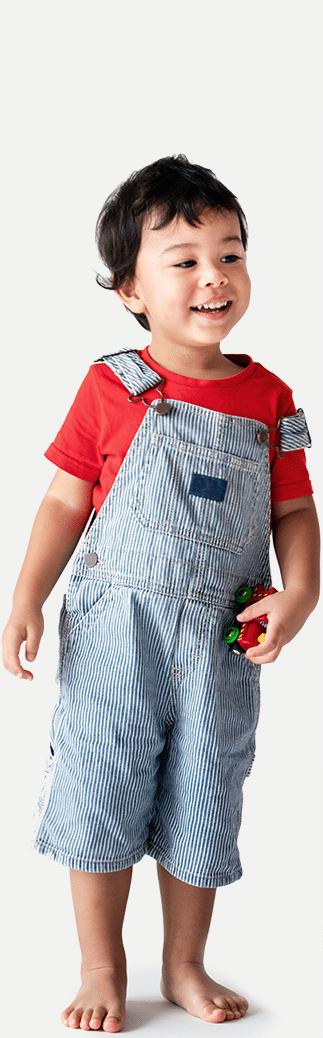 preschool boy in overalls