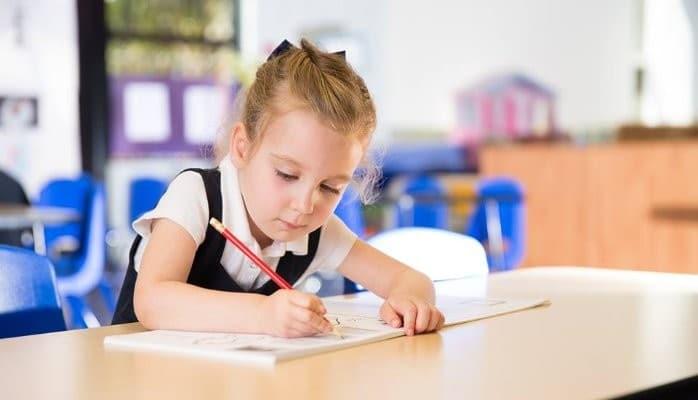preschool prekindergarten girl writing with pencil