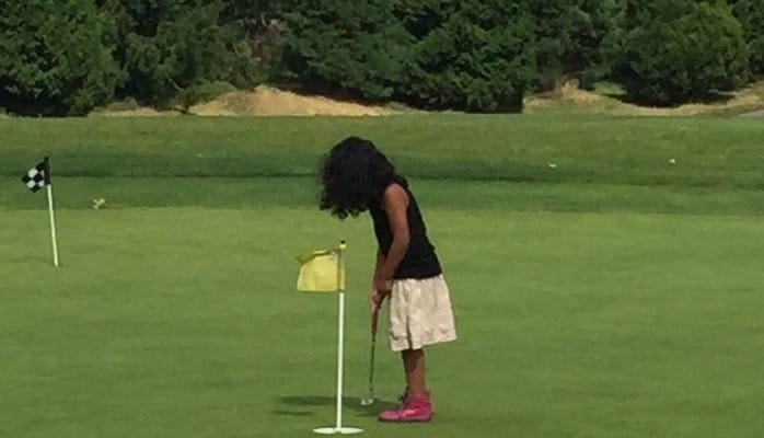 daycare activities young girl golfing