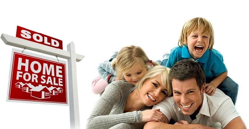 dad next to a mom with two kids on their backs next to a home for sale sign that says sold on top