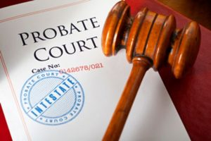 a picture of a wooden gavel on probate documents