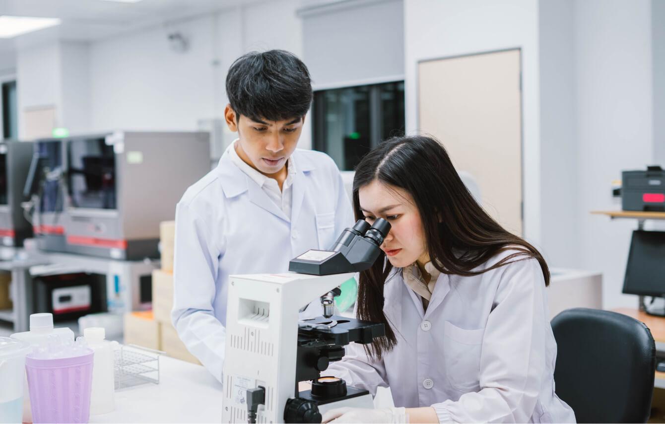 drug-safety-expert-overlooking-researcher-compress