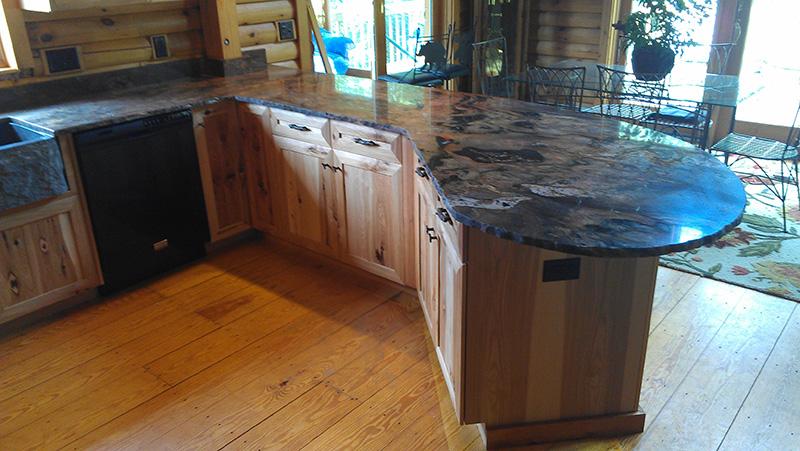 Rustic hickory cabinets, granite sink, Brazilian fusion chiseled edge countertop