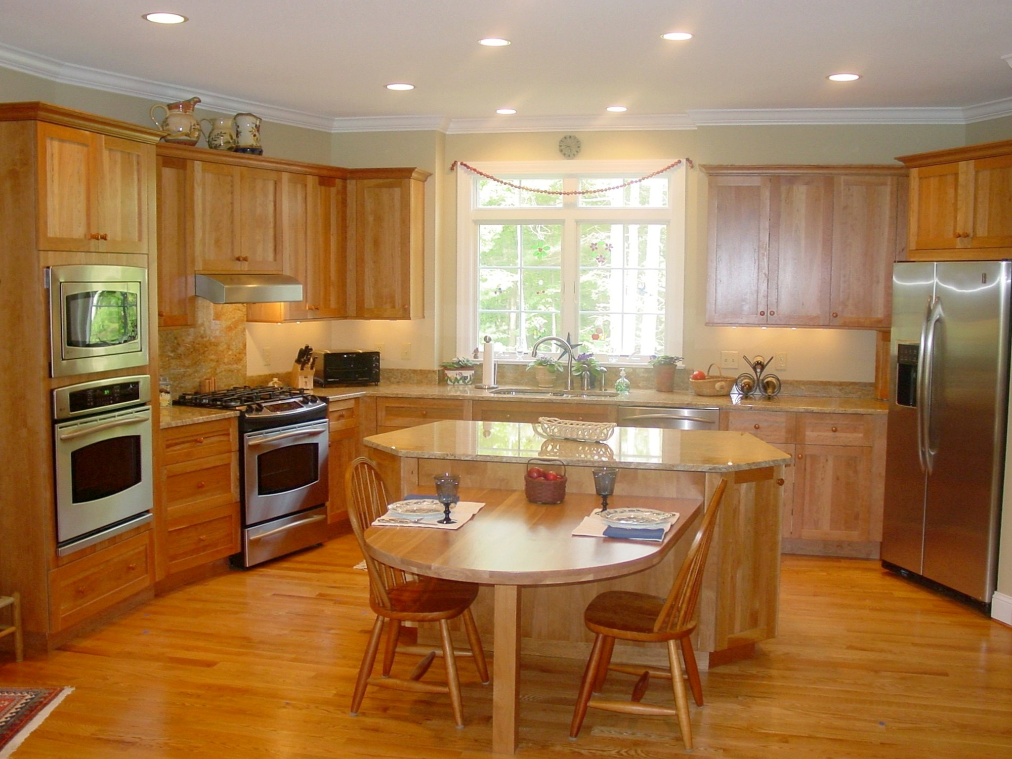 Adelphi Kitchens Cabinetry, Shaker Doorstyle in Natural Red Birch. GE Profile Appliances.