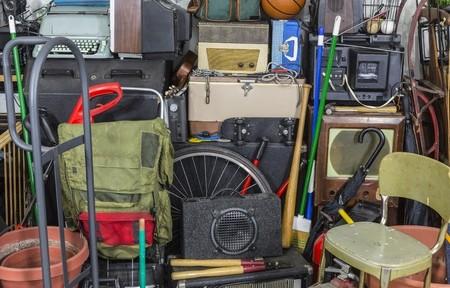 54386874 - vintage rummage junk pile storage area mess.
