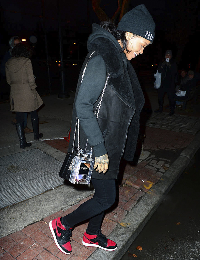 Rihanna carries her new Chanel Perfume bottle purses while out at lunch in NYC