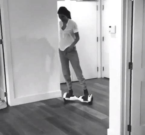 Kendall Jenner casually rides around an apartment ending in a little crash and burn.