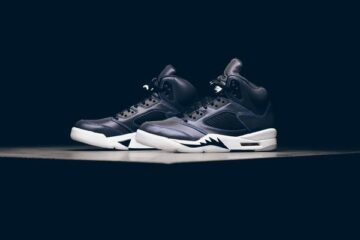Air Jordan 5 Retro 'Oil Grey' with a black background