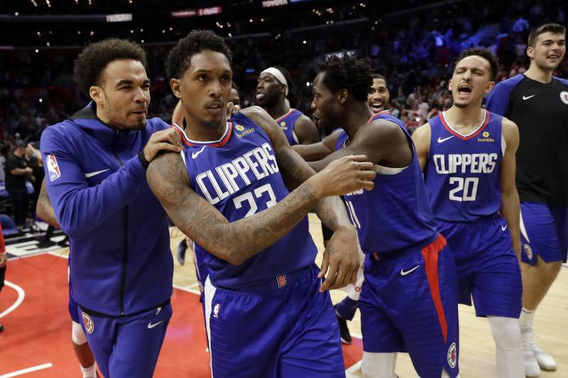 Patrick Beverly seen celebrating with his Clippers teammates in 2019