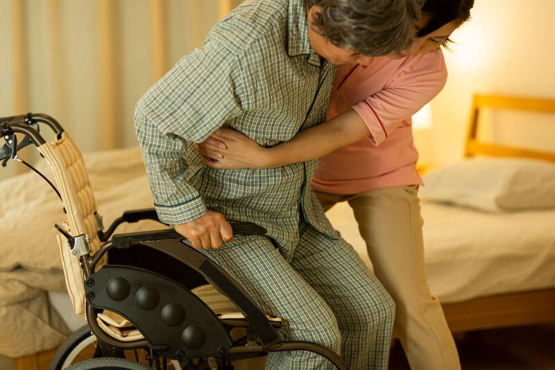 Helping A Senior Out of Bed - Housecall Doctors