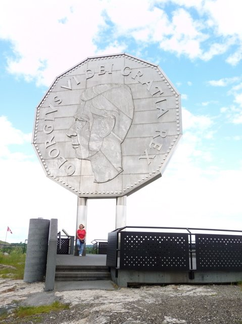 Sandra Poses With The World's Largest Coin
