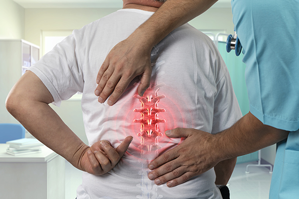 orthopedic spine surgeon dr. javier reto examines a male patient