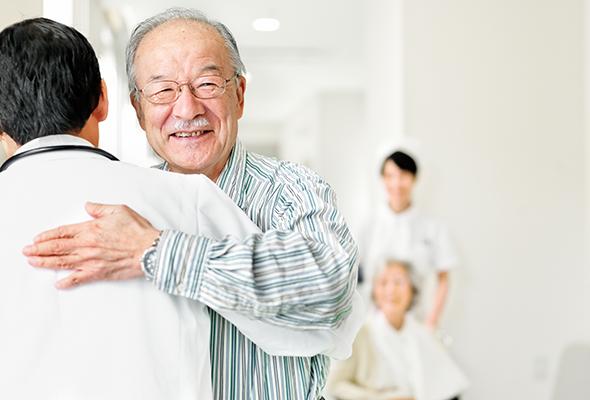 dr. javier reto hugging patient after orthopedic spine surgery