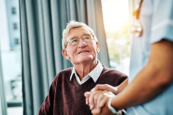 orthopedic spine surgeon dr. javier reto embraces patient