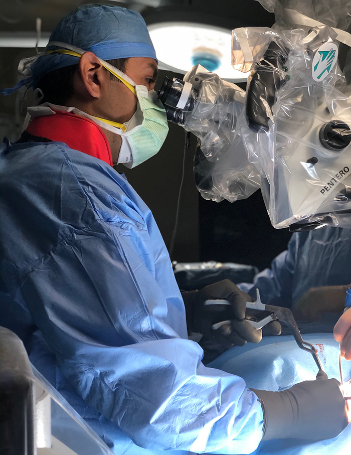 orthopedic spine surgeon dr. javier reto operates on patient