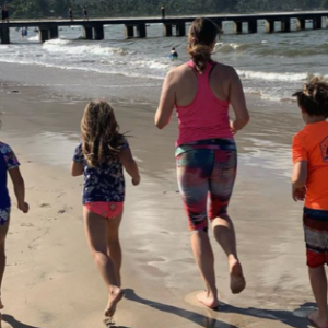 Anne Peled, M.D. Running on the beach with children - Exercising After Breast Cancer Surgery