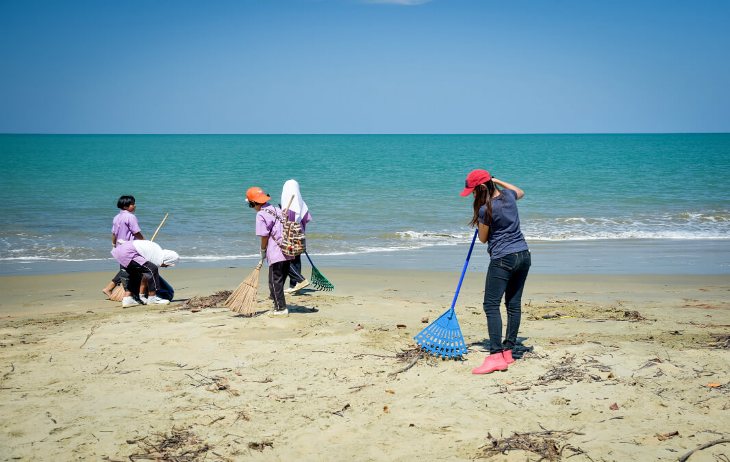 People cleaning the beach