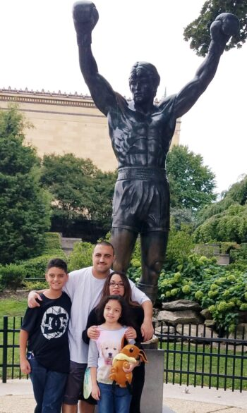 The Fontanez Family in front of the Rocky Statue in Philly