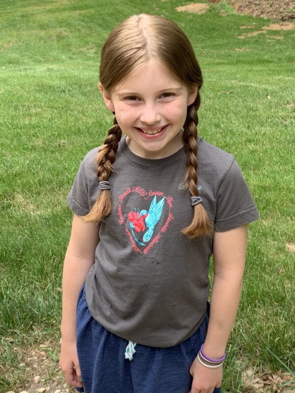Sophia in her Hummingbird T-shirt