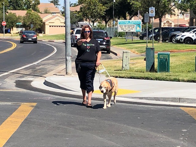 Andrea and Newcastle start crossing the street