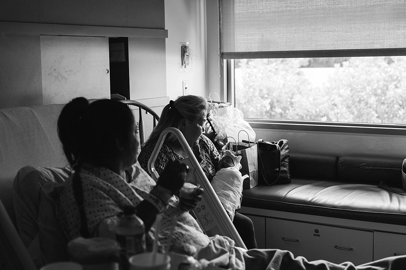 mom grandma and newborn baby girl in hospital