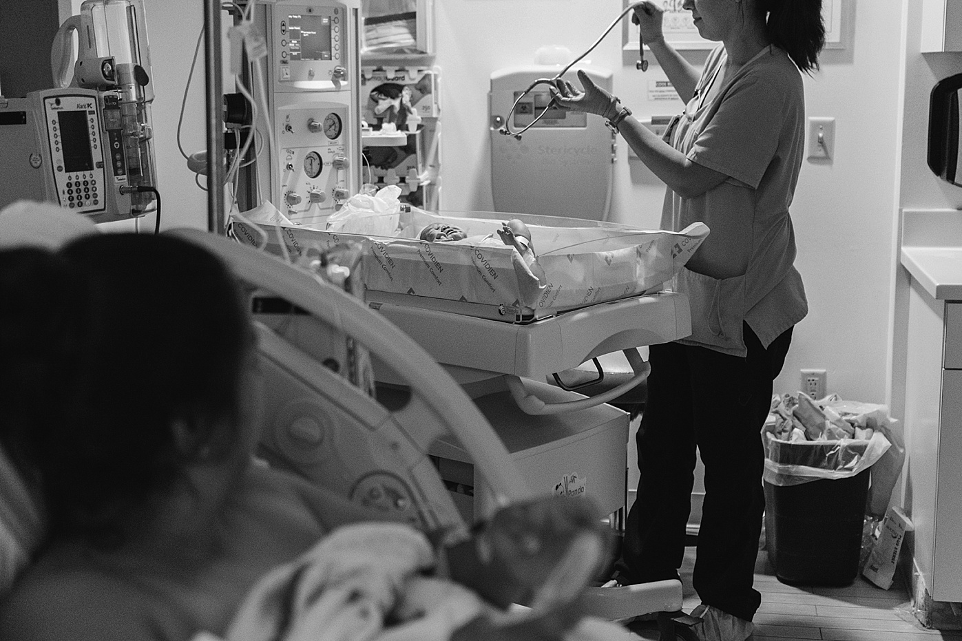 newborn being examined in hospital after birth