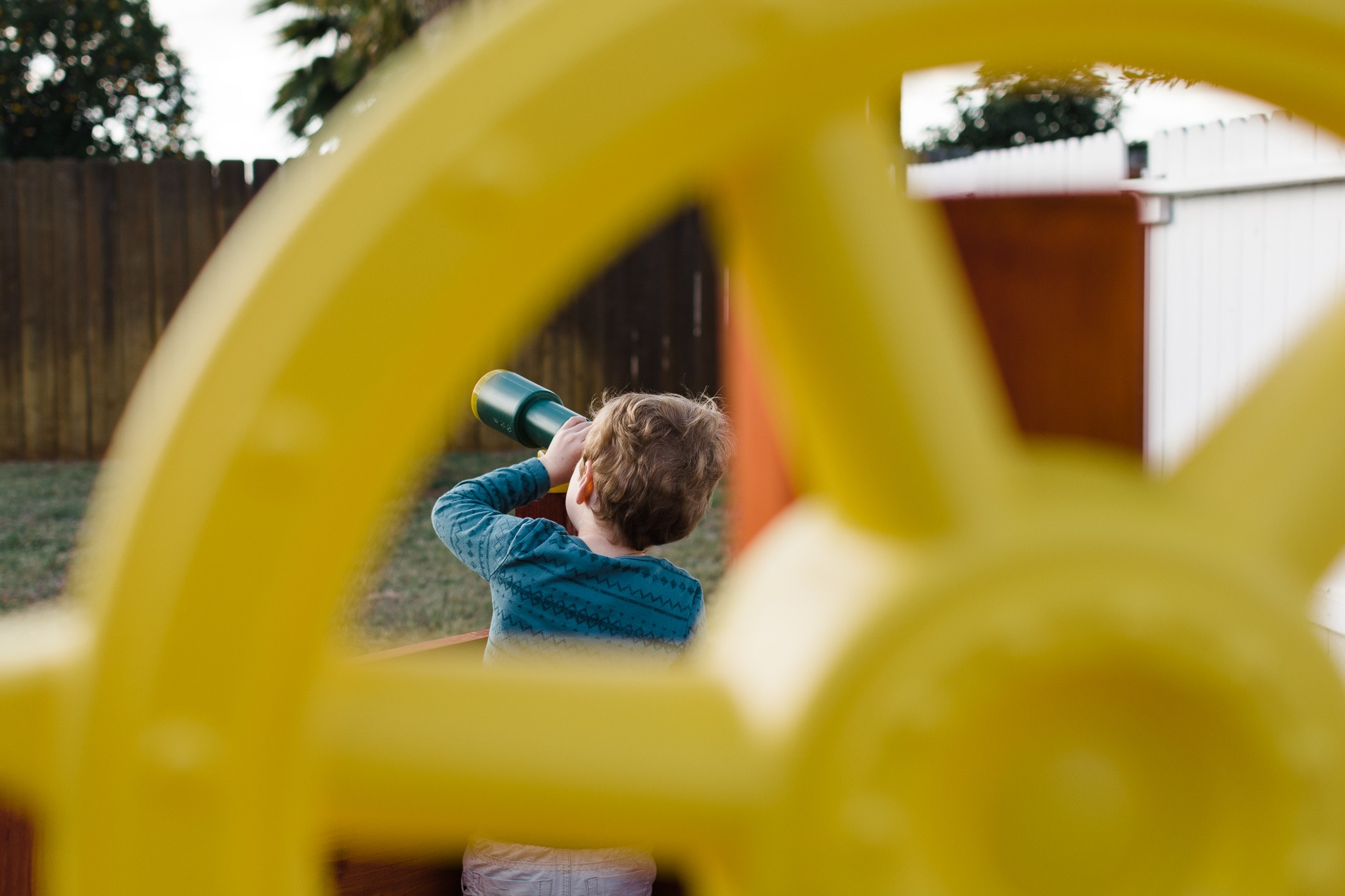 boy playing on jungle gym documentary family photography