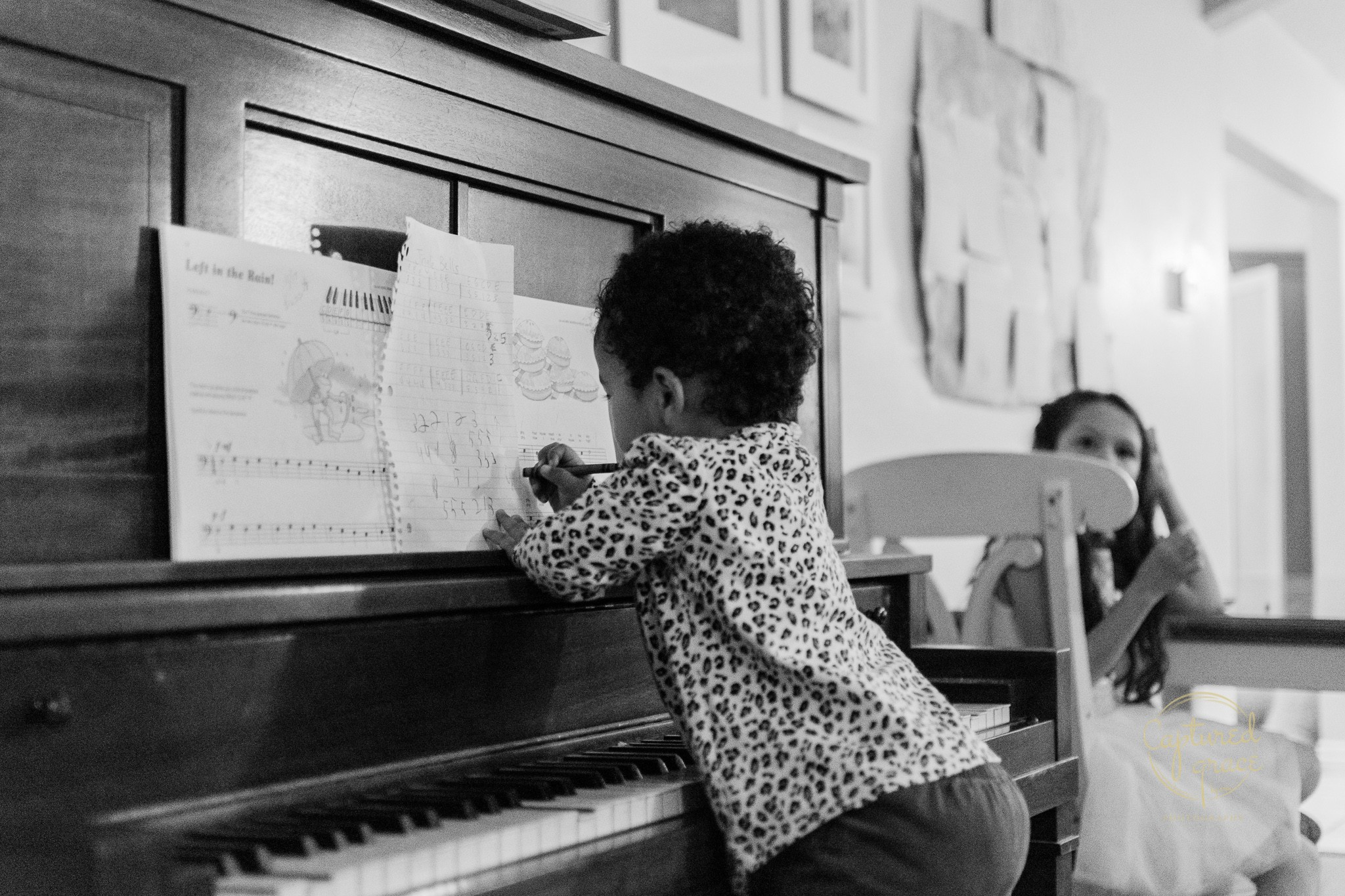 toddler girl playing piano documentary family photography