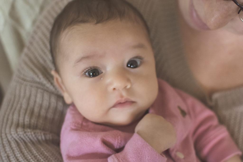 Newborn girl portrait captured grace by erin
