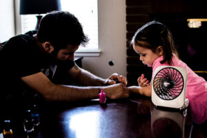 Dad painting toddler girl nails family photography redlands