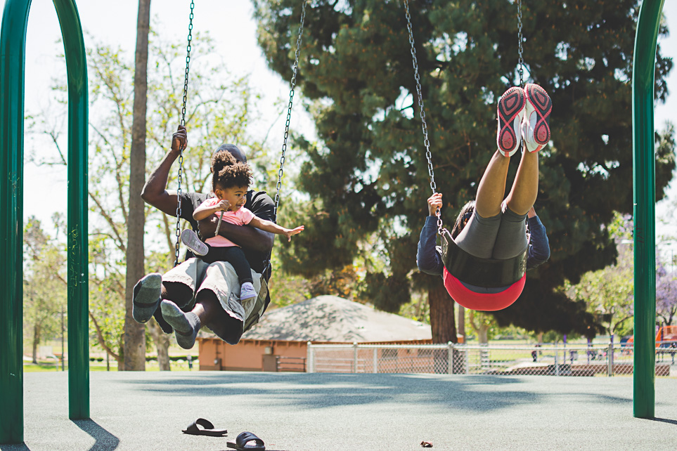 Mom and dad swinging with toddler girl family photography redlands