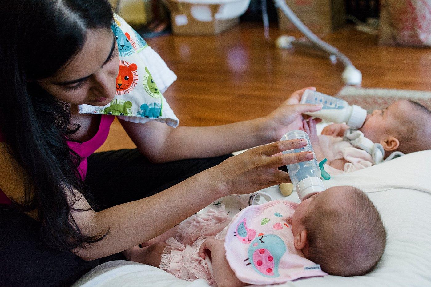 mom bottle feeding newborn girls captured grace by erin family photography redlands