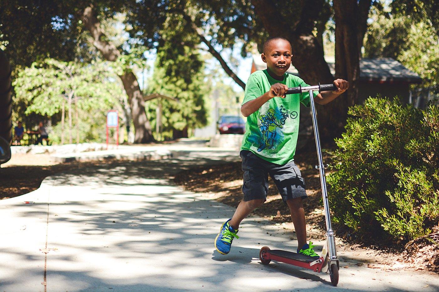 boy riding scooter at schoolhouse park oak glen family photography