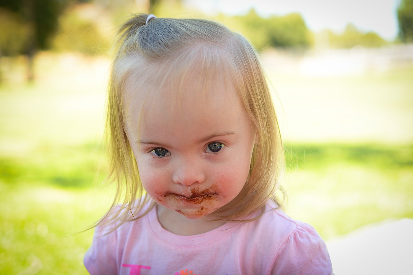 toddler girl with chocolate face ford park redlands captured grace by erin family photography