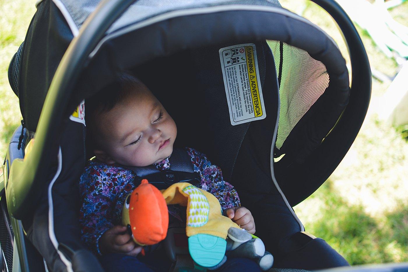 newborn sleeping in car seat snow line orchard oak glen captured grace by erin photography