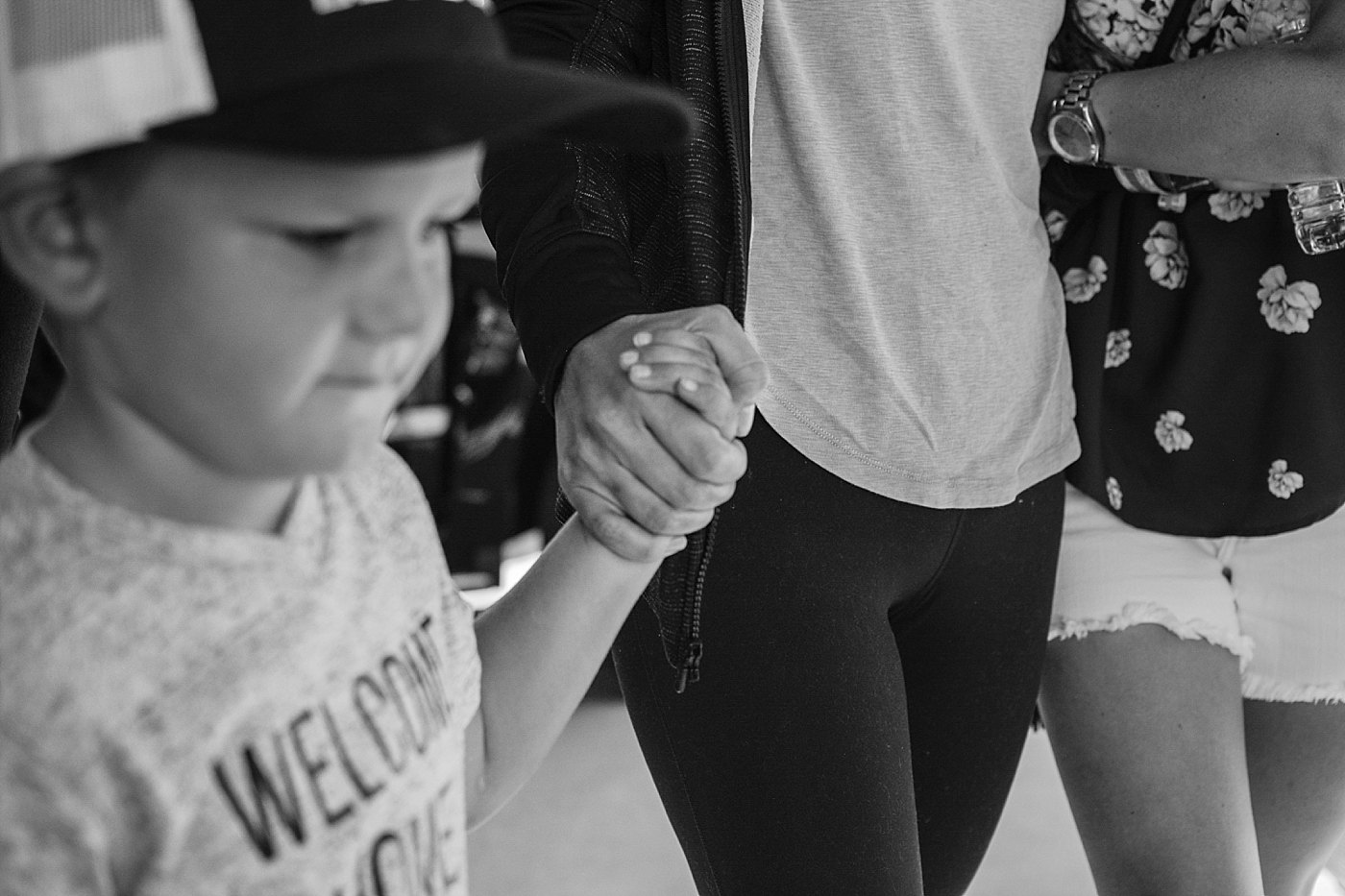 son holds moms hand homecoming las vegas shooting victim Chelsea Romo Captured Grace by Erin