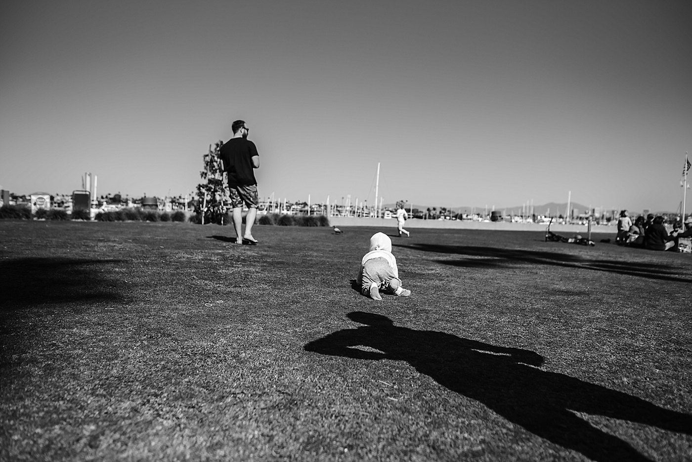 toddler crawling in dads shadow newport beach redlands family photograper