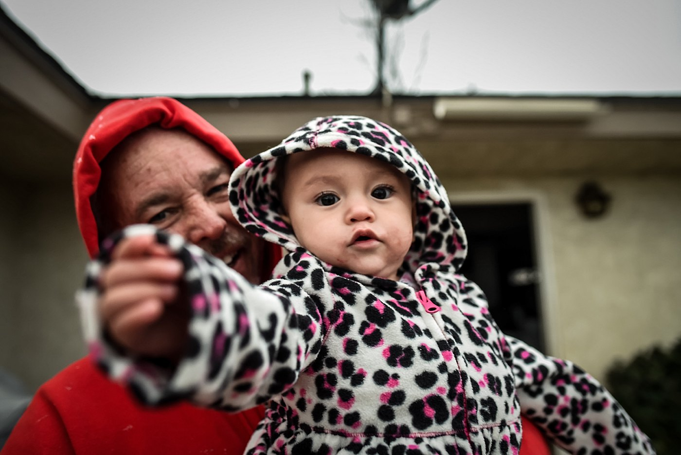 toddler with grandpa in snowfall yucaipa redlands family photograper