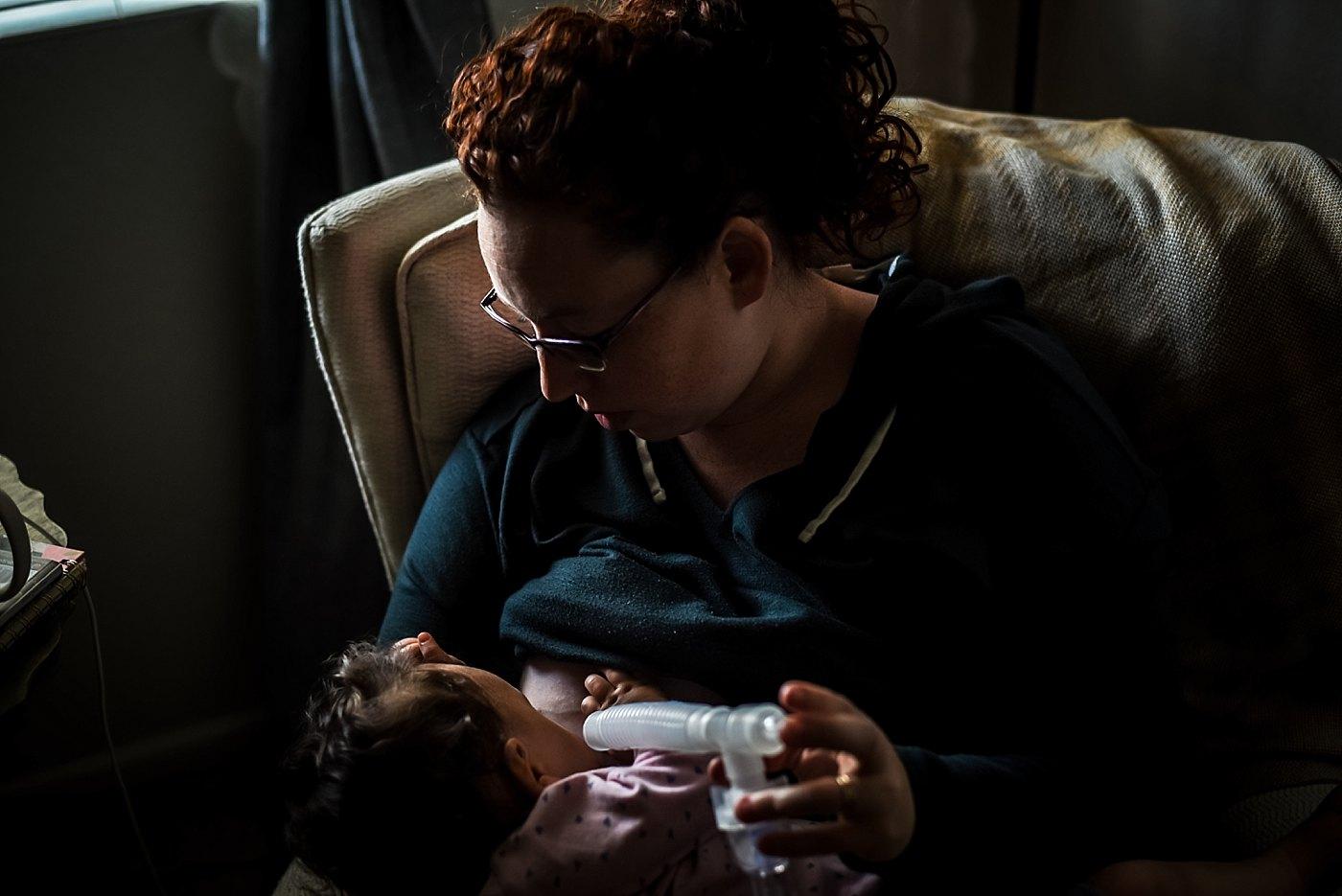 mom giving toddler girl breathing treatment yucaipa redlands family photograper