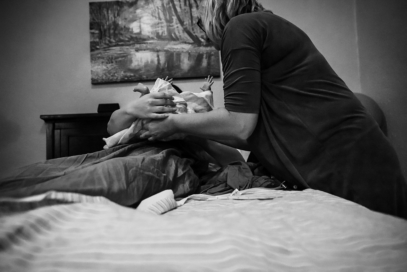 midwife hands baby to mom Yucaipa birth photographer