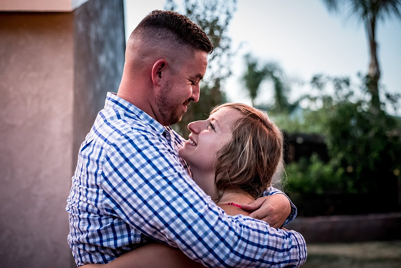 man woman embrace backyard proposal redlands family photographer
