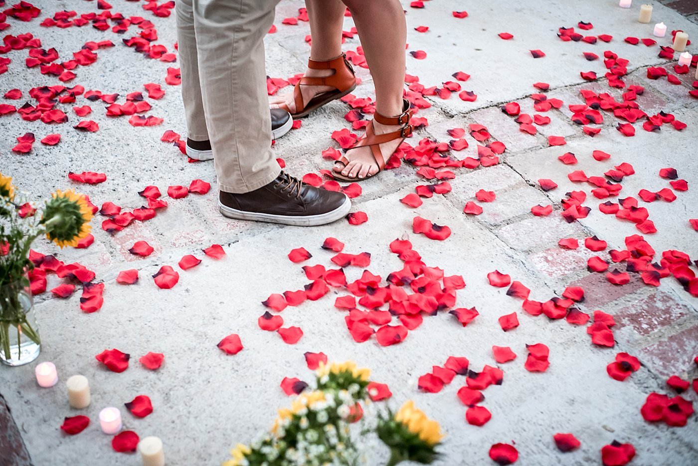 boy and girl feet in rose petals backyard proposal redlands family photographer
